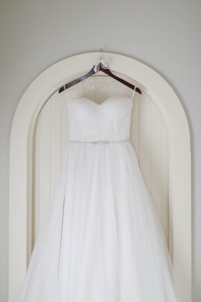 dress hanging in manor at eastern shore wedding at kirkland manor by costola photography