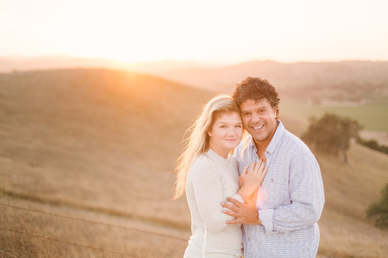 Bride and groom embrace while overlooking Santa Ynez Valley