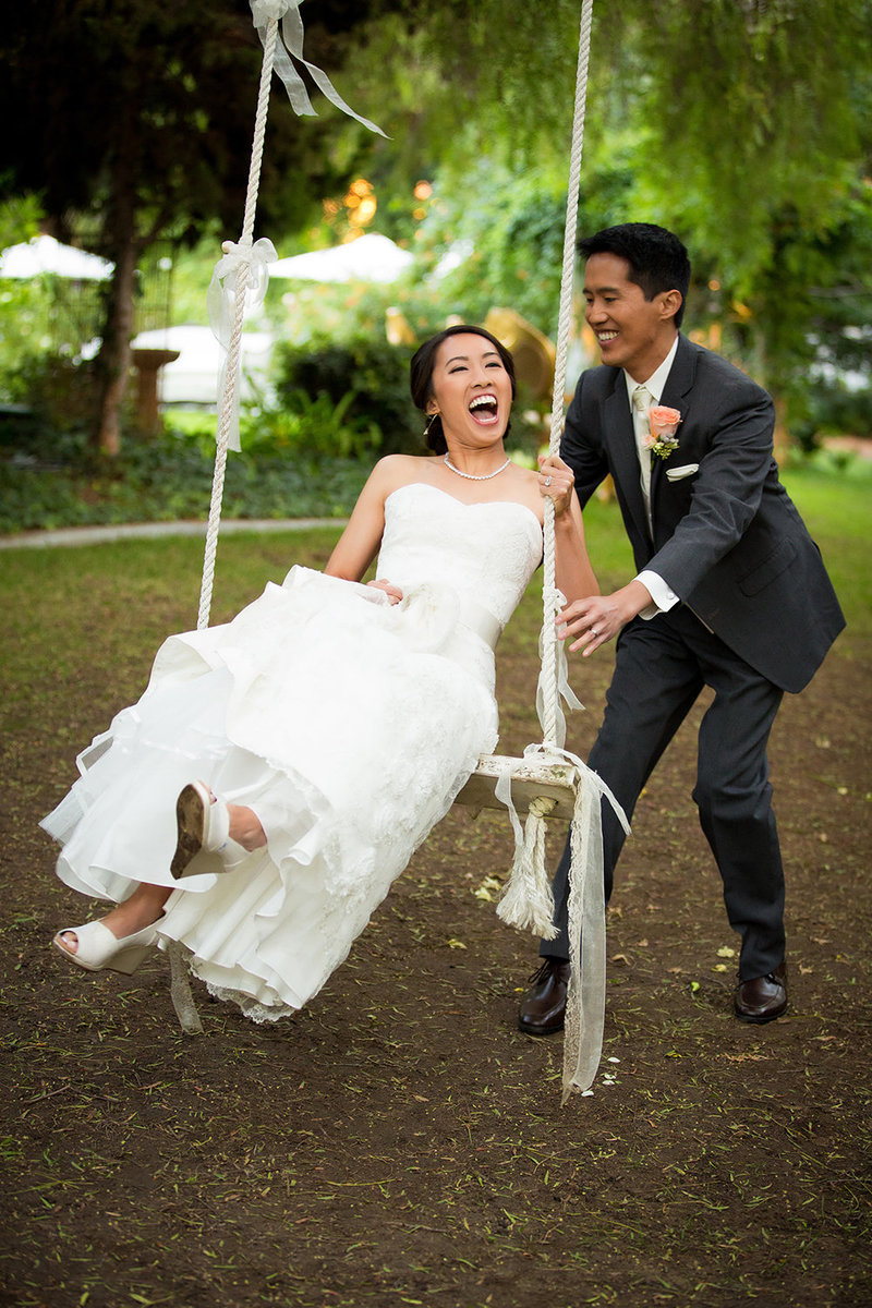 Green Gables wedding photos bride on swing laughing