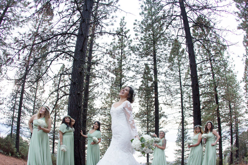 bride with bridesmaids in forest