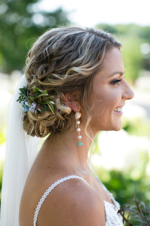 bride smiling with flowers in her hair