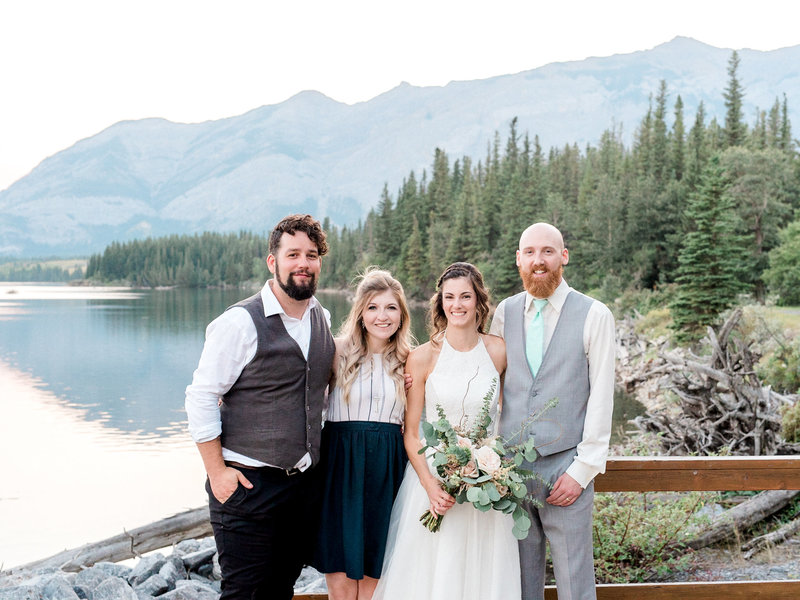 Steven and Steph posing with a bride and groom in the mountains