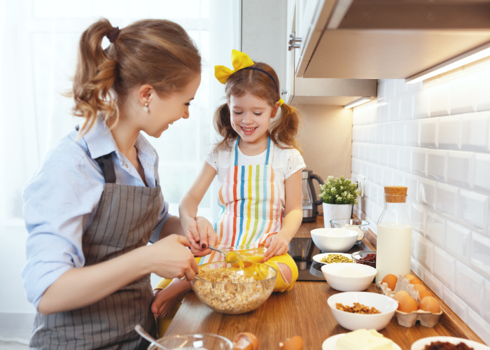 Thrive by Spectrum Pediatrics image for article titled responsive feeding therapy values and practices is a child and mother preparing food together for mealtime