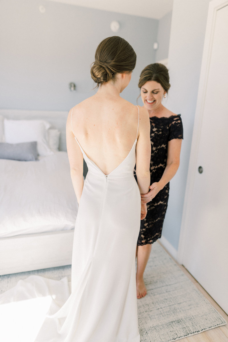 Mom admiring bride on her wedding day