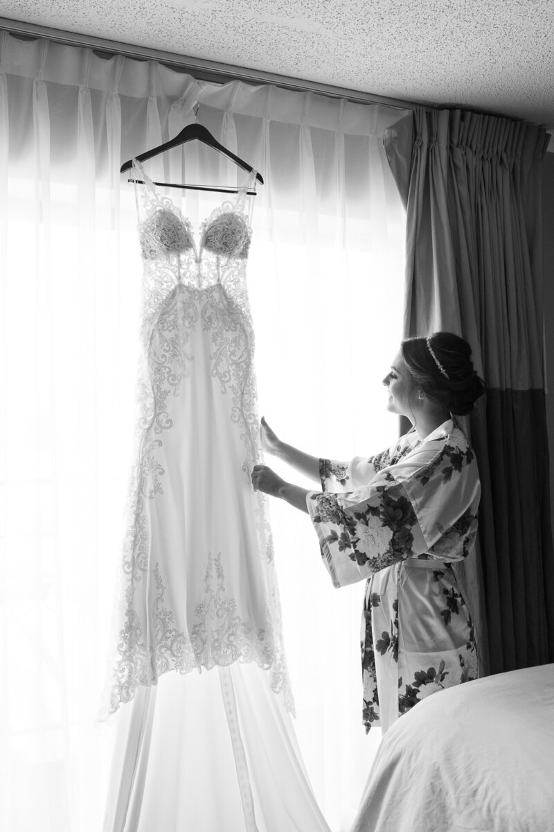 bride touching her wedding dress on wedding day