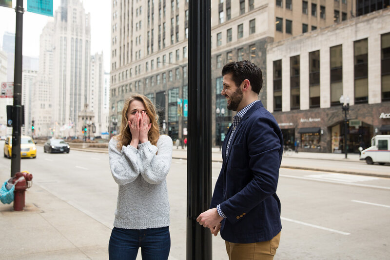 woman gasping from surprise after engagement proposal woman gasping from surprise engagement downtown chicago mag mile