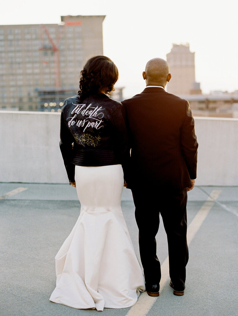 Bride and Groom on Rooftop with leather jacket