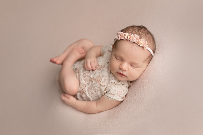 columbus ohio newborn photographer baby girl in blush with cream outfit