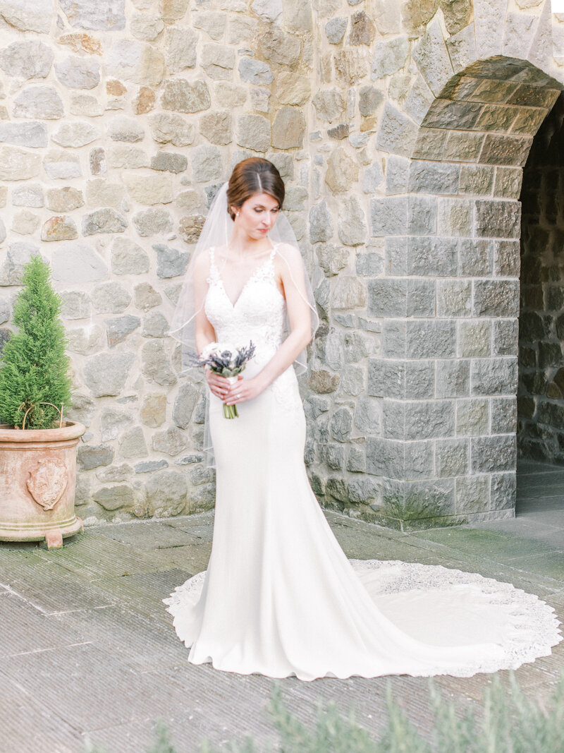 Bride in front of Tuscany Italy Wedding Venue Bride in front of Relais La Corte Dei Papi