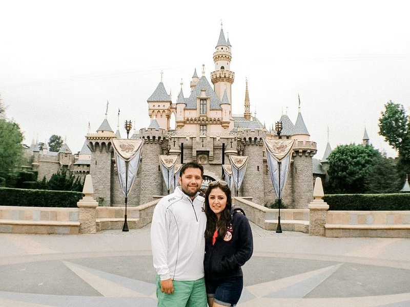 Couple in front of Disneyland castle