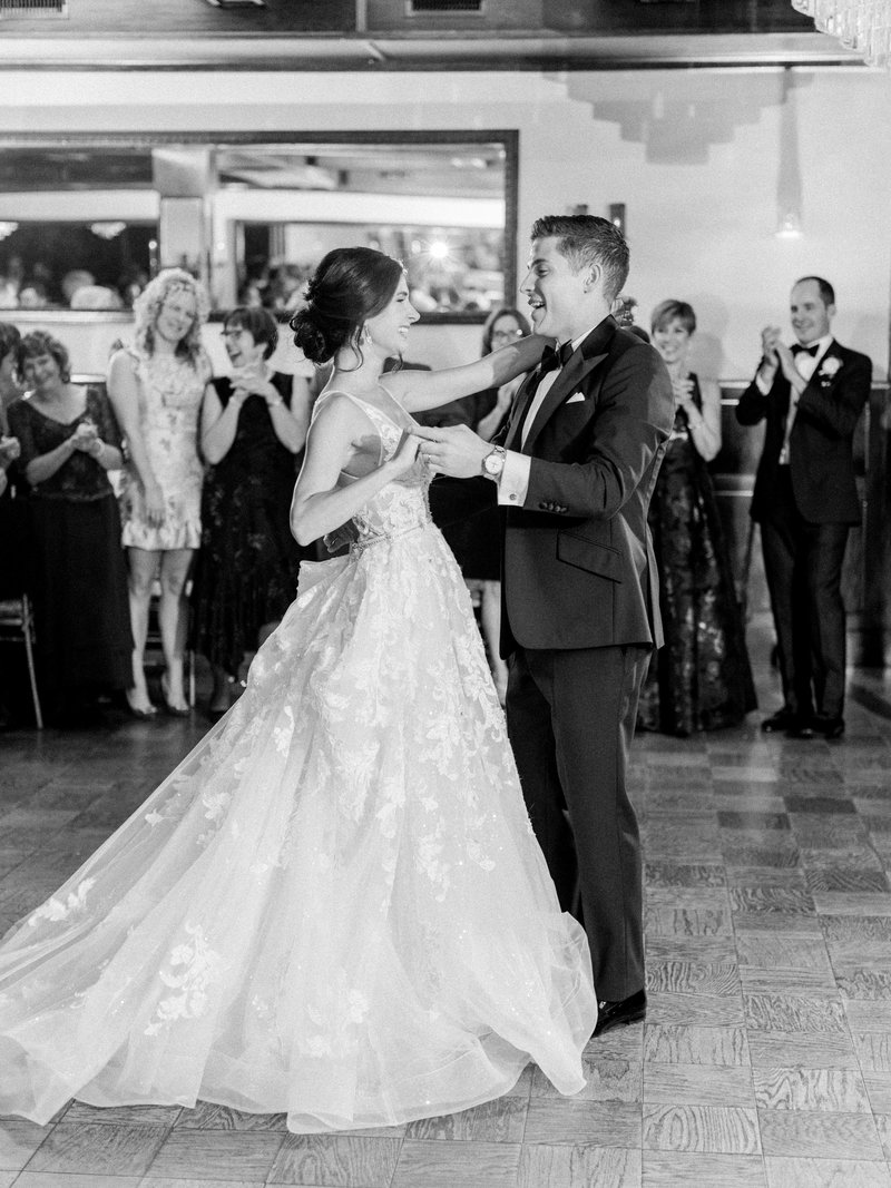 bride and groom twirl around the dance floor for their fist dance