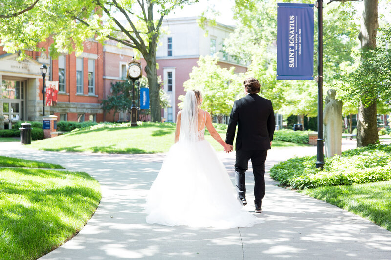bride and groom walking st. Ignatius school cleveland