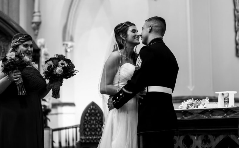 Bride and groom share first kiss at St. Peter's cathedral wedding in Erie, PA