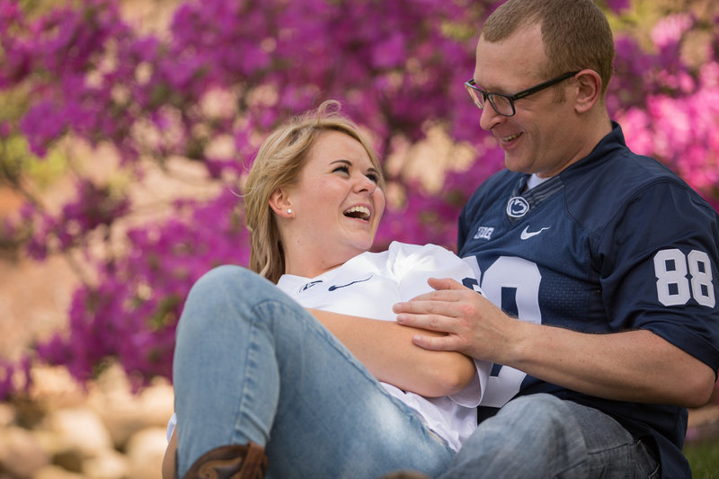 Engaged couple laughing during Penn State Erie engagement photo session