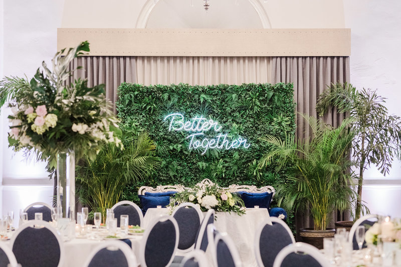 neon light and greenery backdrop for reception at Don Cesar wedding in St Petersburg Florida by Costola photography