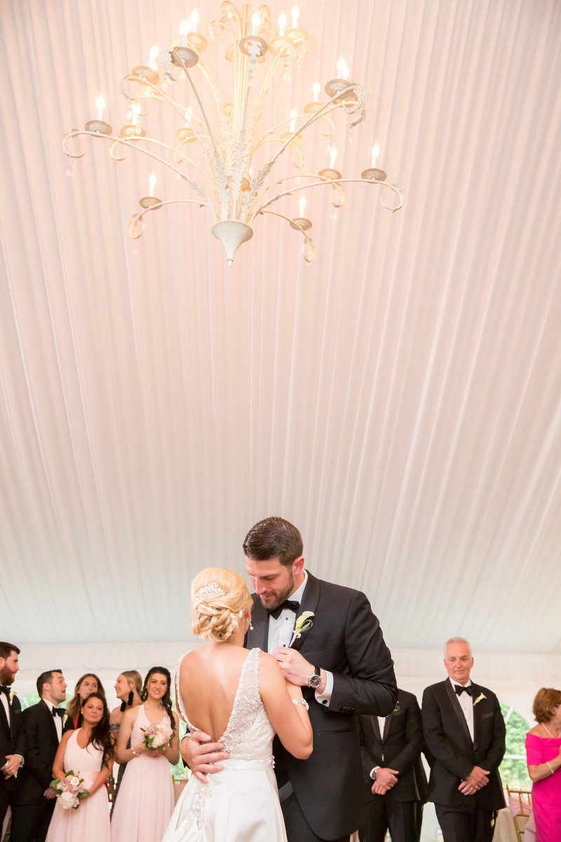Bride and groom in tented reception by NJ Wedding Photographers