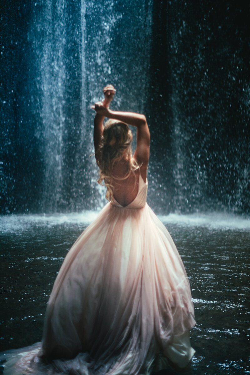 elopement-bride-dancing-in-a-waterfall