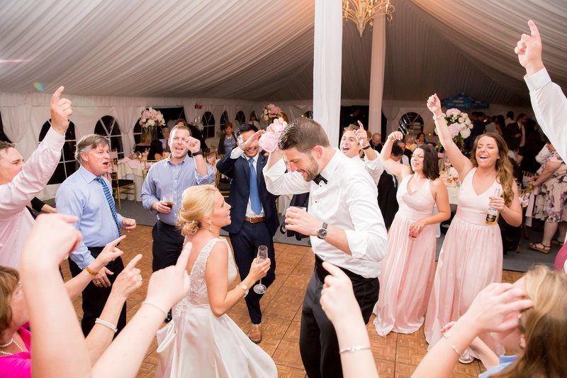 Dancing in tented reception by NJ Wedding Photographers