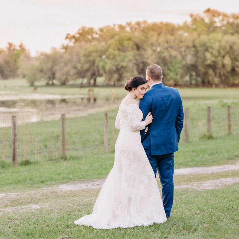 Bride and Groom by lake at Lakeside Ranch