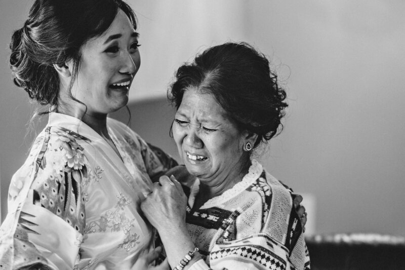bride and her mother embracing and crying