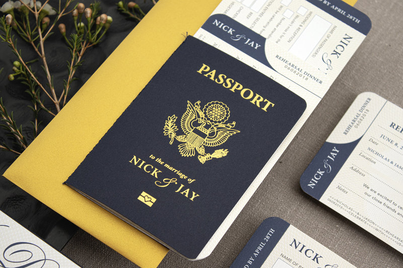 Passport wedding invitation complete with gold foil on a beautifully textured navy card-stock and sewn navy binding.