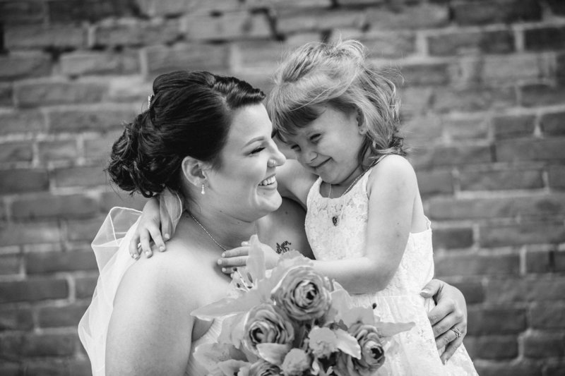Bride holds her daughter at her Brewerie wedding