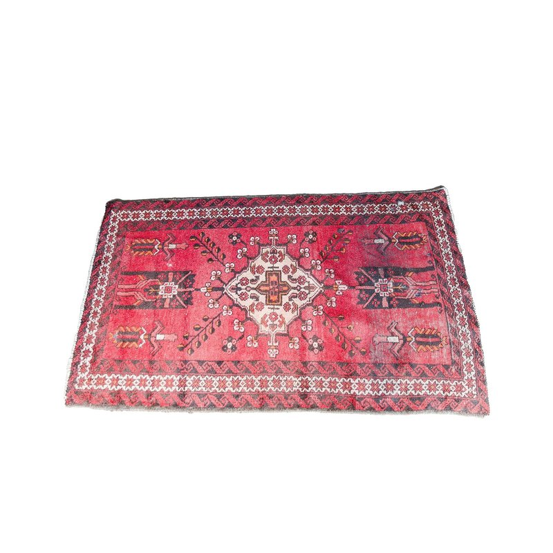 Vintage tribal rug with red and mustard accents.