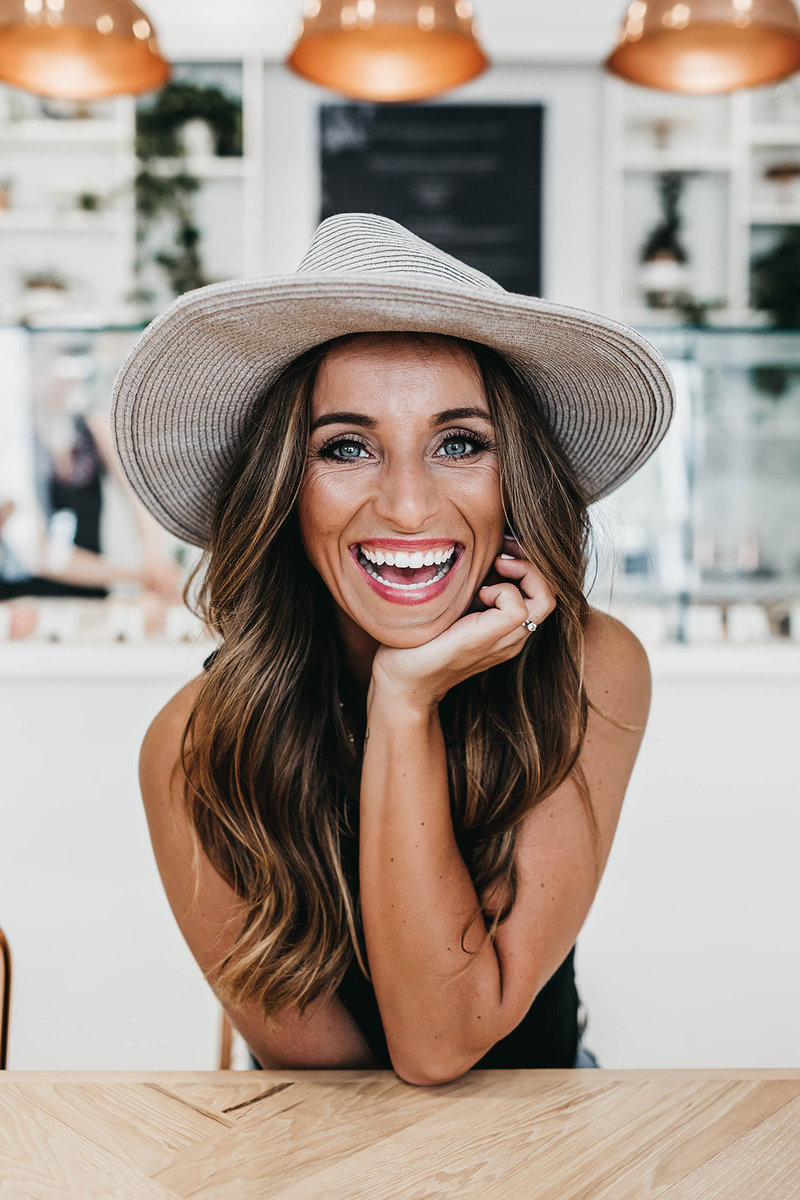 woman wearing hat while smiling
