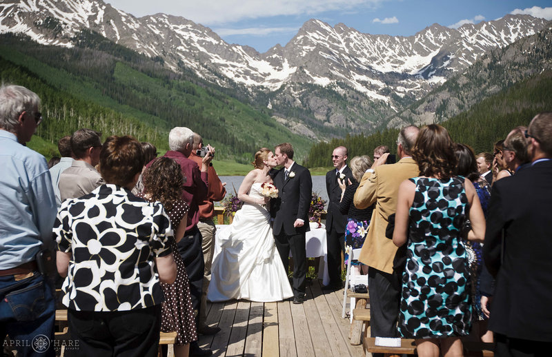 Kissing on the deck at outdoor Vail Wedding Ceremony