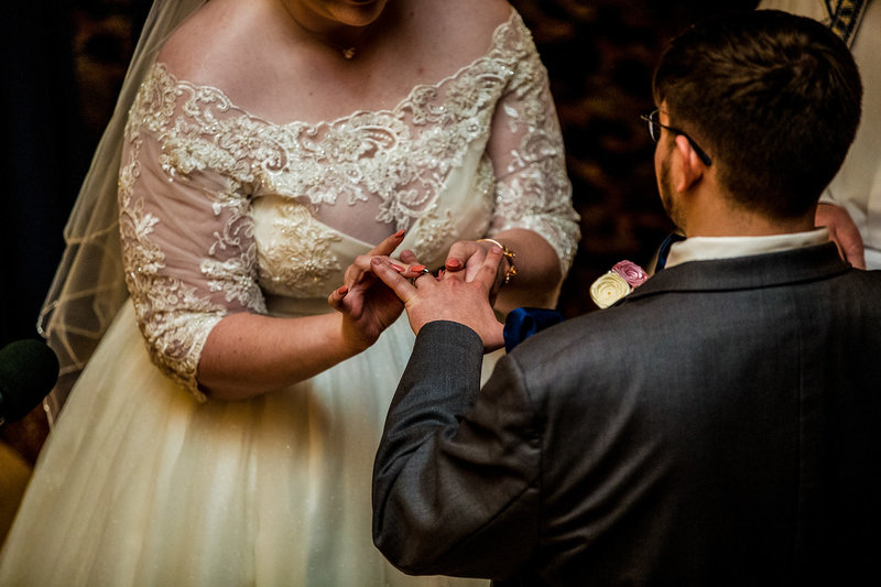Couple exchanges rings during Warner Theatre wedding ceremony