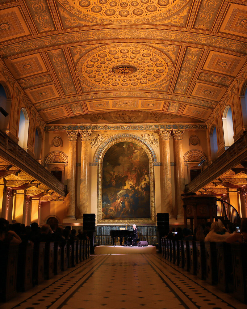 A celebrity performer playing at The Old Royal Naval College in London, planned by a luxury wedding planner london