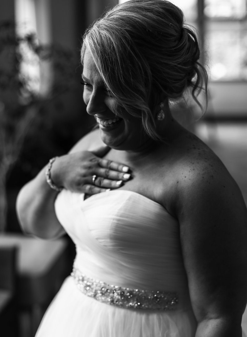 Solo portrait of bride in her dressing room before her Edinboro University wedding