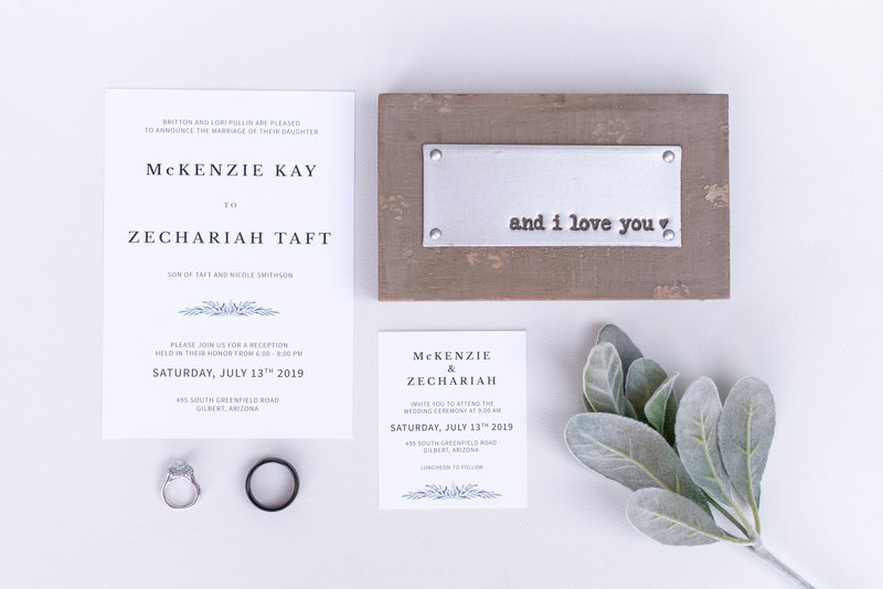 flat lay wedding invites and rings