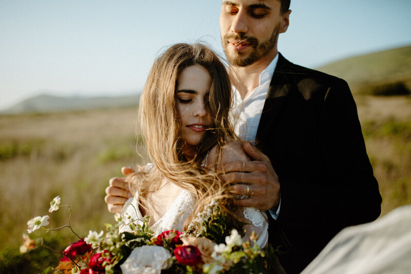 Couple hugging each other during their adventure elopement