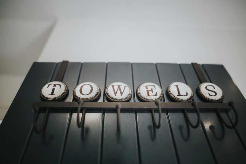 Towel Rack spelling out the word towels