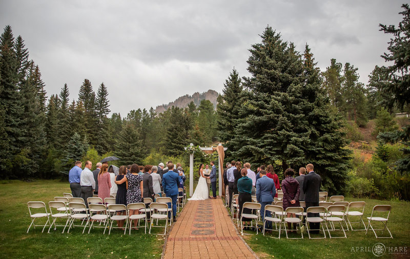 Outdoor Rainy Wedding During Summer at Wedgewood Weddings Mountain View Ranch