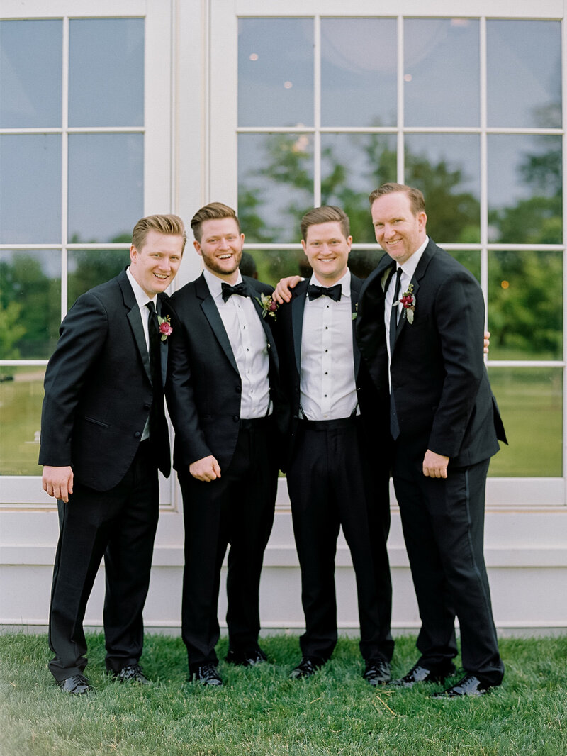 Groomsmen in Black Tux with Suspenders