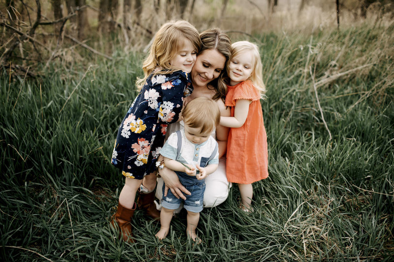 Rebecca Joslyn Photography owner with her children