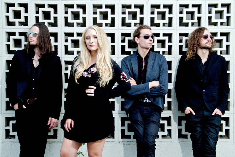 Nashville Country Music Group Portrait Juliana Hale And BAnd Of Roses standing in front of wall of patterned concrete blocks