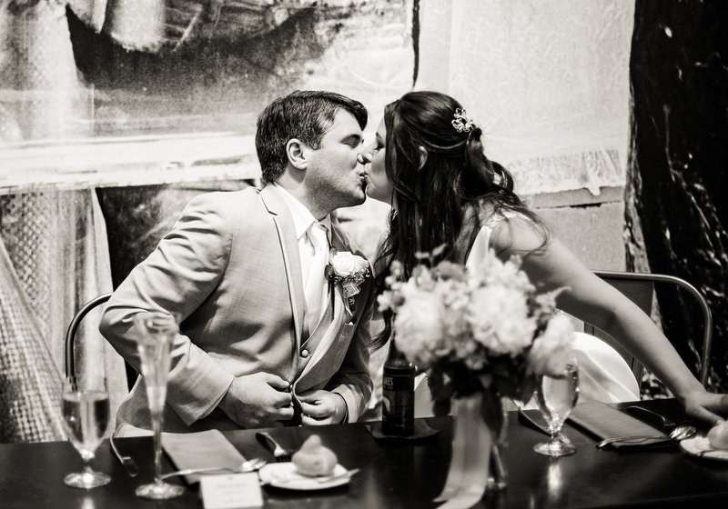 Bride and groom kiss during their Andy Warhol Museum wedding reception