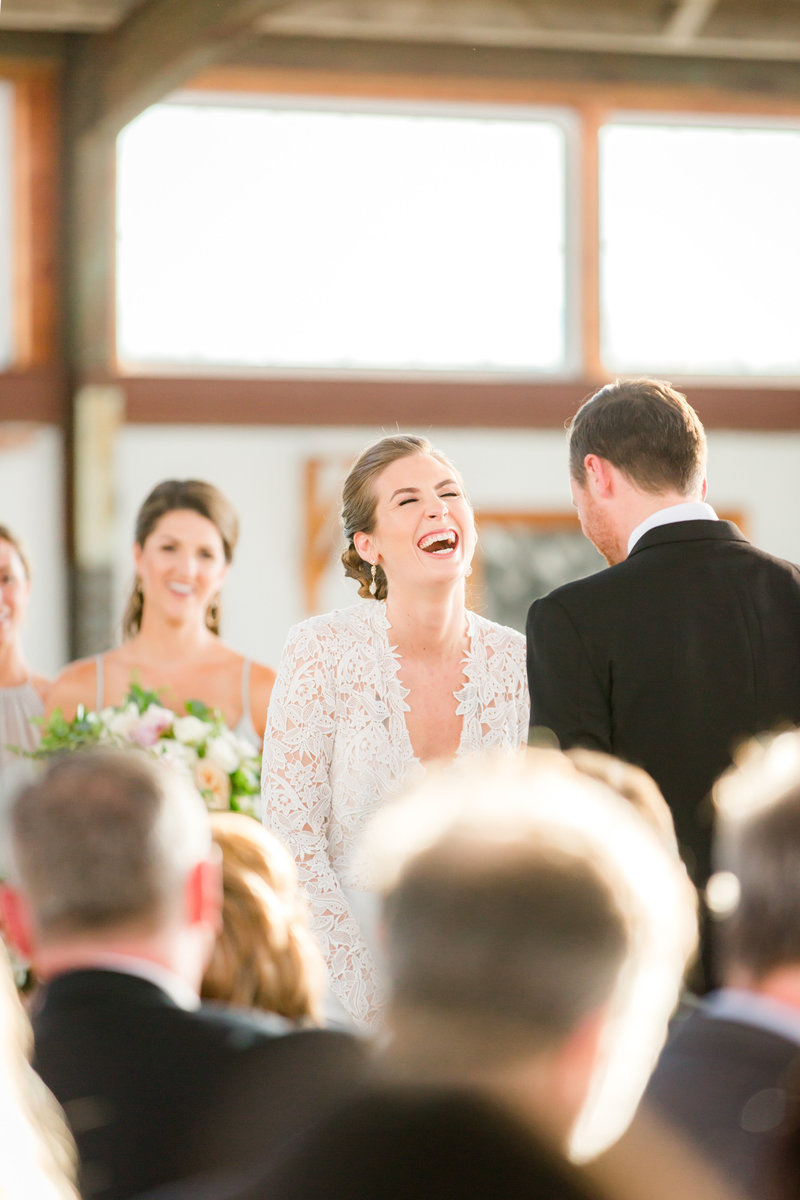 Joyful bride at Bay Head Yacht Club wedding ceremony