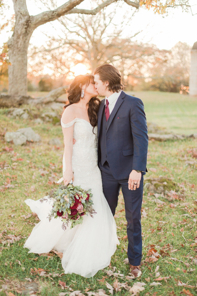 couple kissing at knoll at sunset at great marsh estate wedding in northern virginia by costola photography