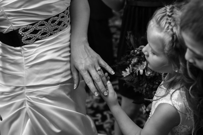 Girl admires her mom's new wedding ring at Warner Theater wedding in Erie, PA