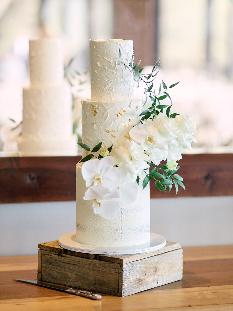 Three teired wedding cake with white flowers