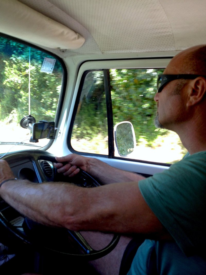 Warren driving our kombi Aggiee on a road trip, New Zealand