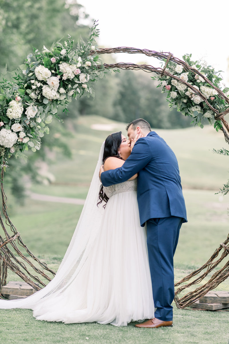 Washington DC Wedding Photography, couple kissing under a floral archway