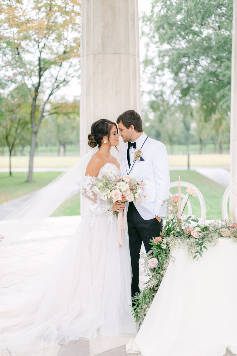 bride and groom kissing by reception space at Washington DC Romantic Classic Wedding at the Lincoln Memorial by Costola Photography