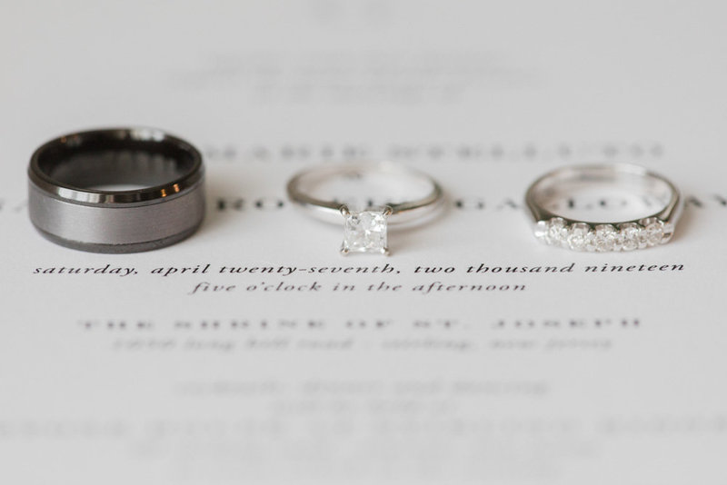 wedding rings on invitation suite  at Stone House at Stirling Ridge Maryland Wedding by  Costola Photography