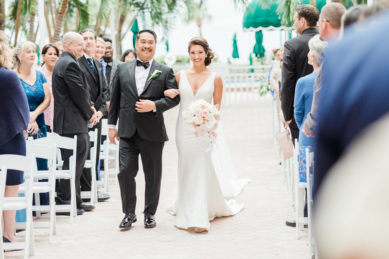 bride walking down the aisle at Don Cesar Wedding Photographer in St. Petersburgh Florida by Costola Photography