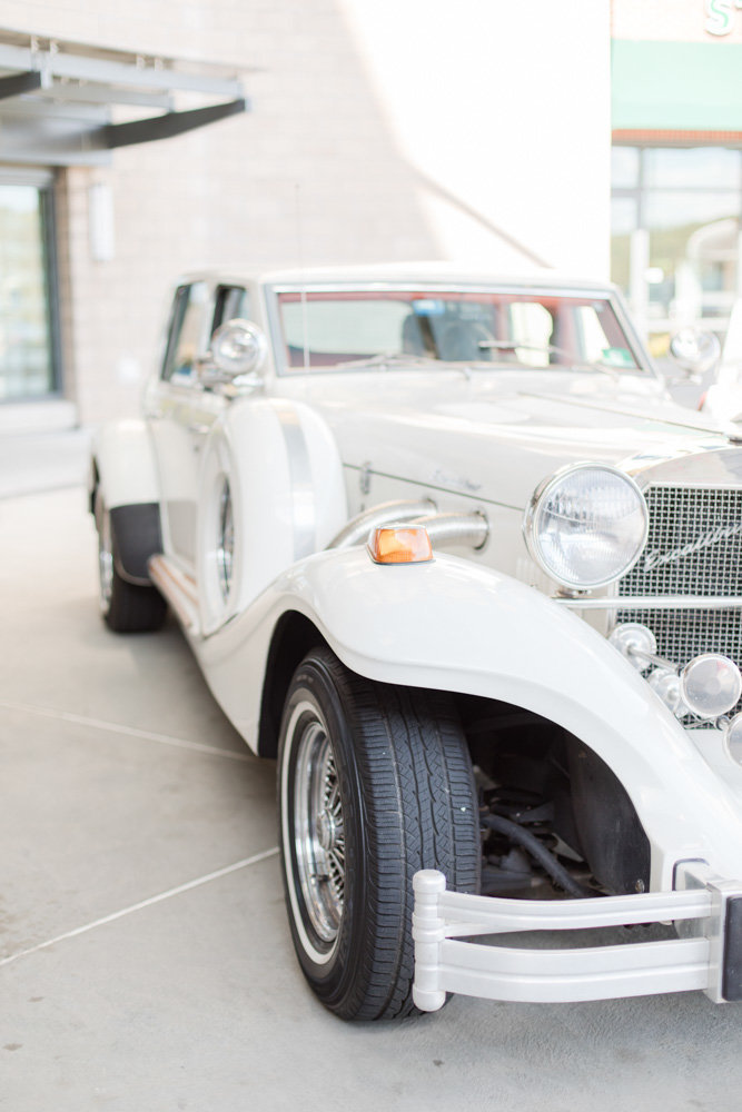 white classic luxury wedding car  at Stone House at Stirling Ridge Maryland Wedding by  Costola Photography